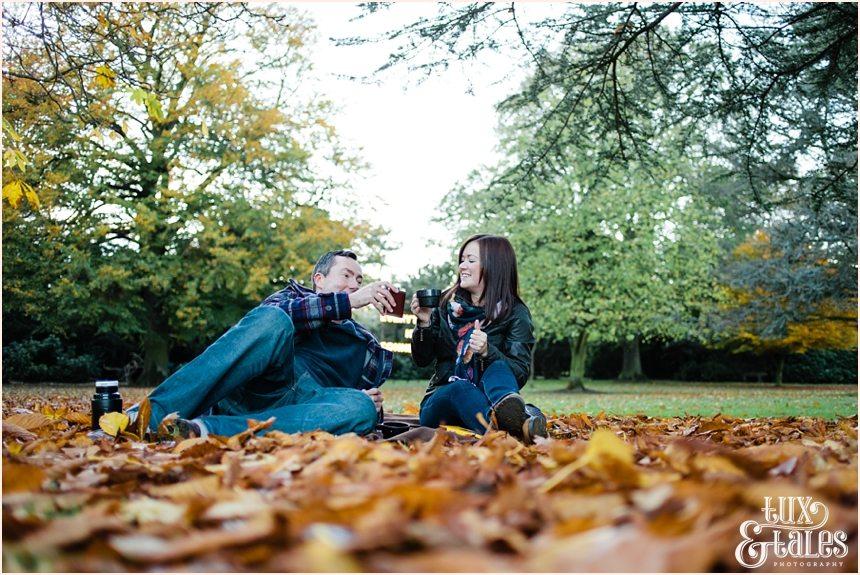 autumn picnic engagement shoot with orange leaves