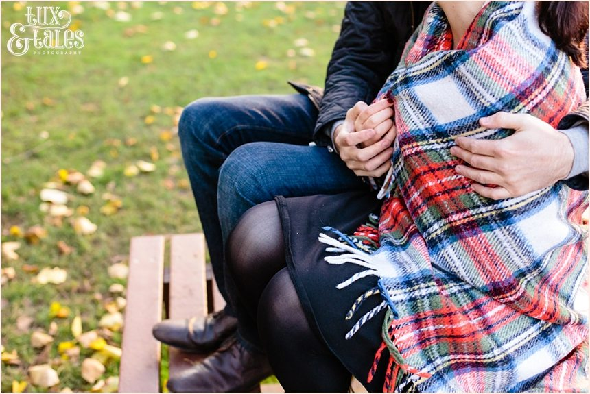 couple wrapped in tartan rug