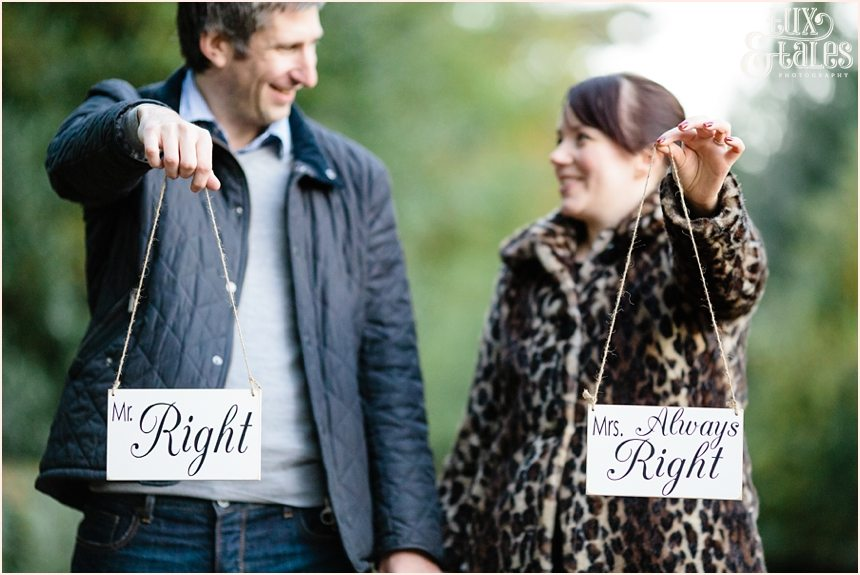 Cute engagement shoot poses couple holding signs