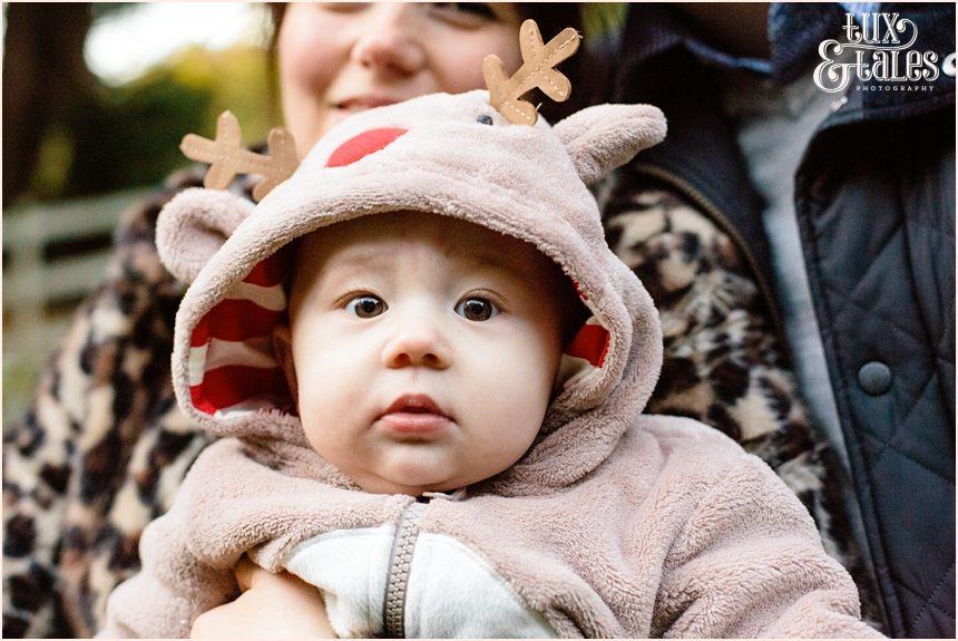 Cute baby in reindeer costume