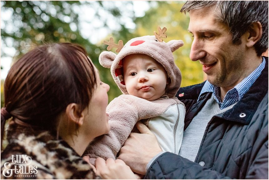 Cute autumn family engagement shoot baby in reindeer costume
