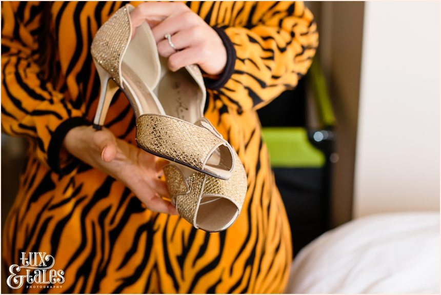 Bride shows gold wedding shoes at Swanland wedding Hull Yorkshire