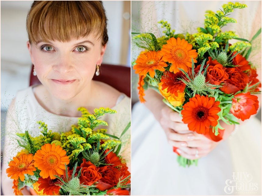 Bride holding autumn themed wedding bouquet