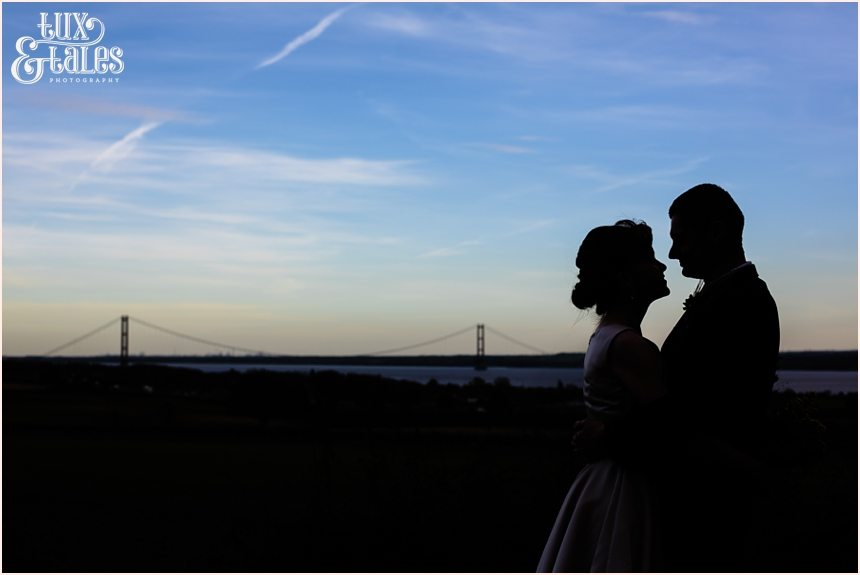 Shillouette of bride and groom in front of humber bridge wedding photography