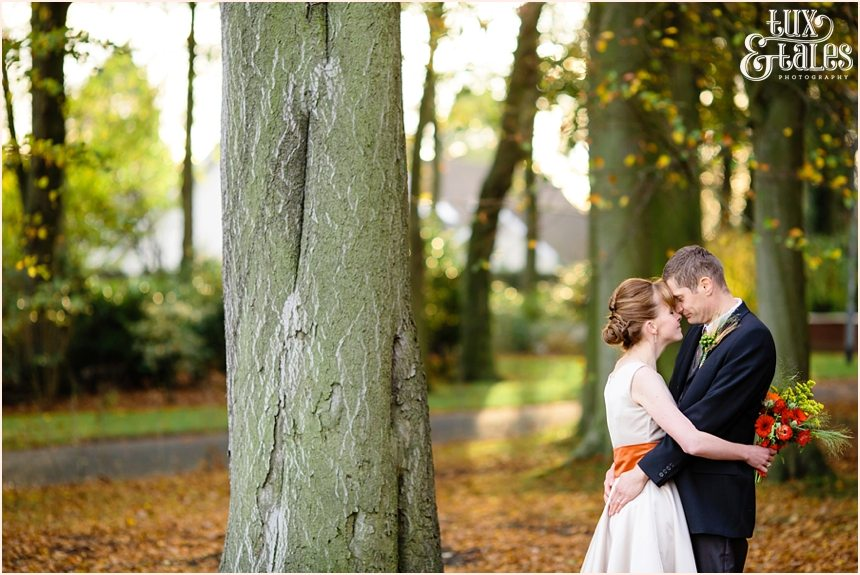 Bride & groom in the autumn leaves in Swanland