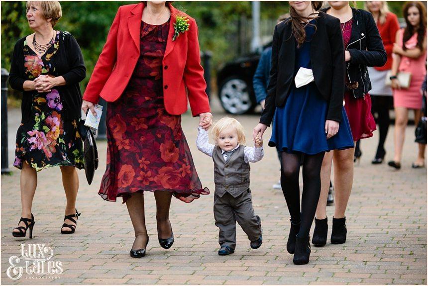 Autumn thtmed wedding little boy walked to mum wearing suit