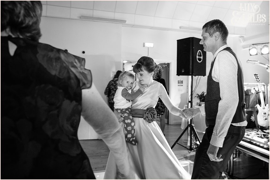 Bride holds son during dance at Hull wedding