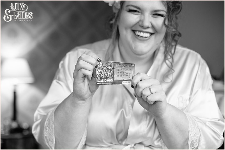 Bride holds up lottery ticket at York wedding