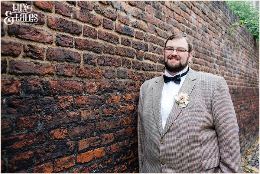 Handsome plus sized groom in tweed