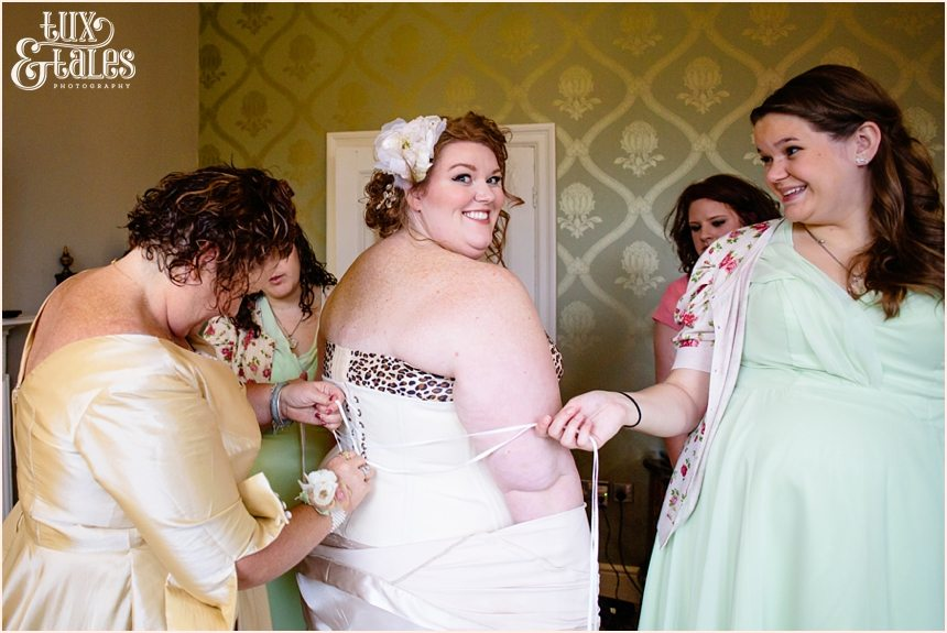 Beautiful plus sized bride has corst laced at work wedding