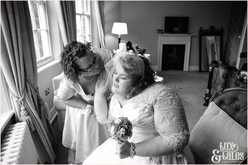 Mother kises bride at York wedding grays court