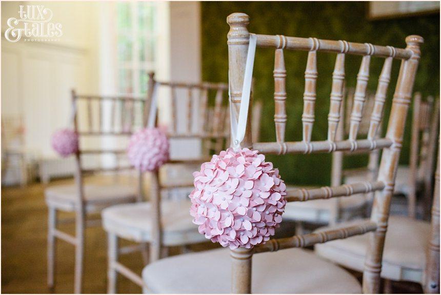 Pink flower ball detail on wedding chair York Grays Court
