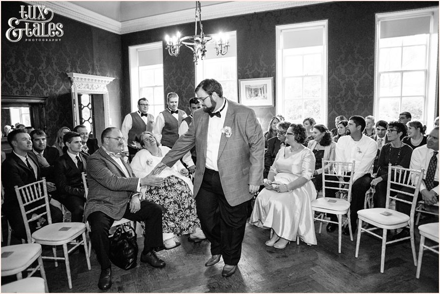 Groom holds mothers hand at Grays Court Wedding