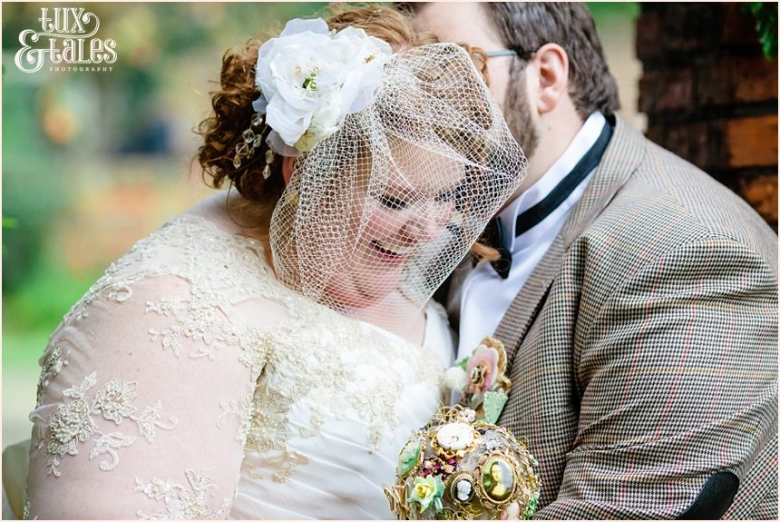 Bride and groom kiss and cuddle after wedding at Grays Court in York