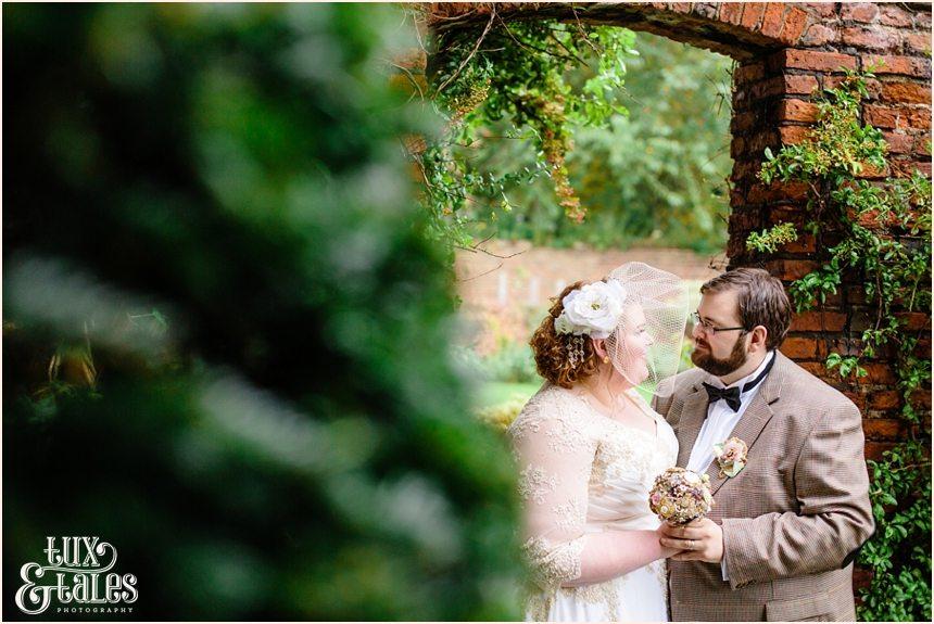 Bride and groom in graden at Grays Court in York