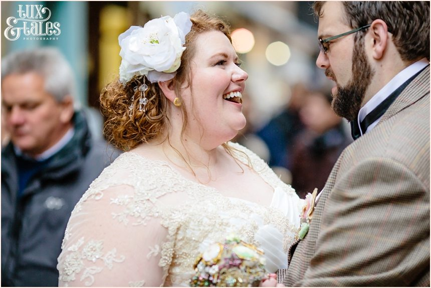 Bride and groom smile on the streets of York wedding