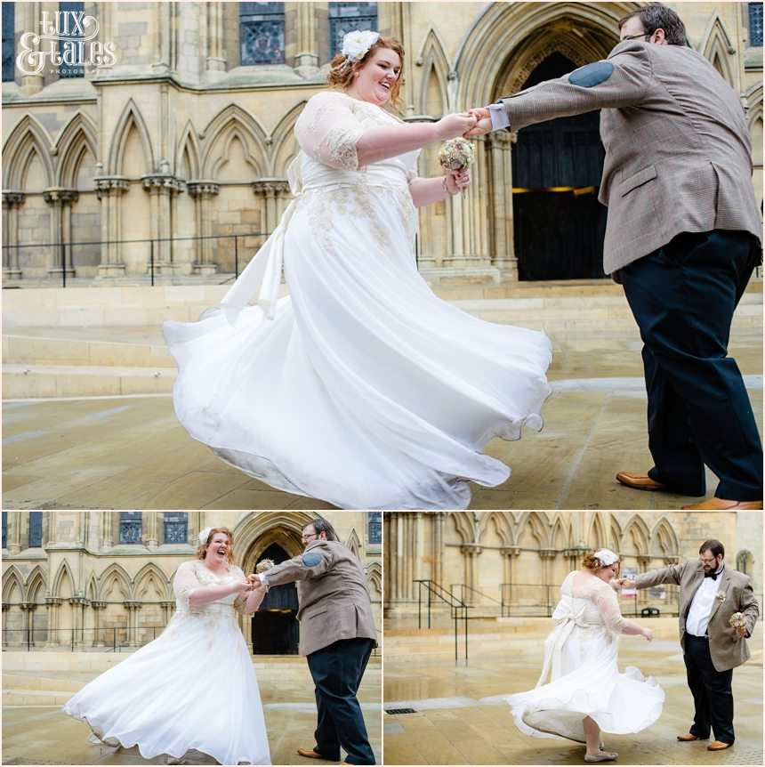 Bride and groom dance out front of the minster at Wedding