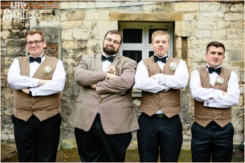 Tweed and black bow ties at Grays court wedding in York arms crossed making silly faces