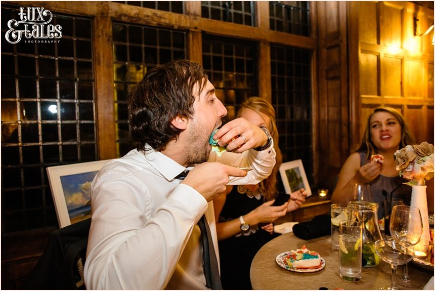 Guest eats cake silly at York wedding