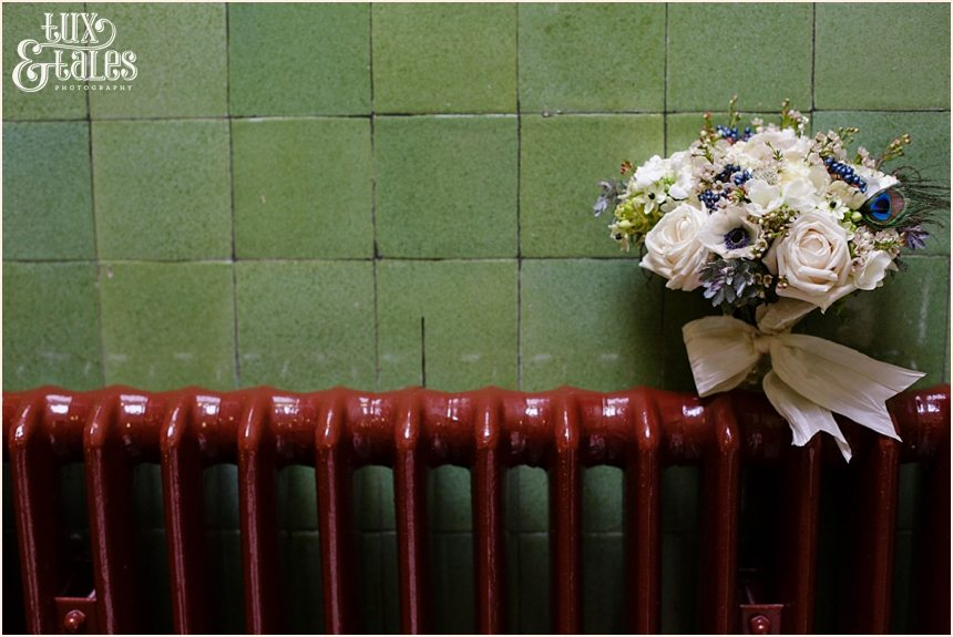 Wedding bouquet in radiator at Cedar Court Grand in York with winter flowers