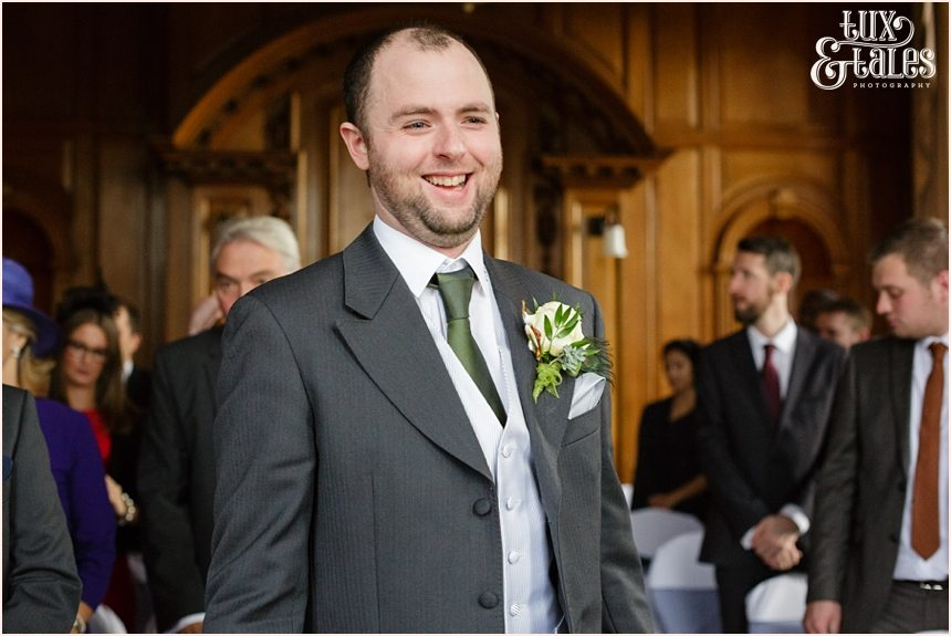 Groom laughs waiting for bride at York wedding