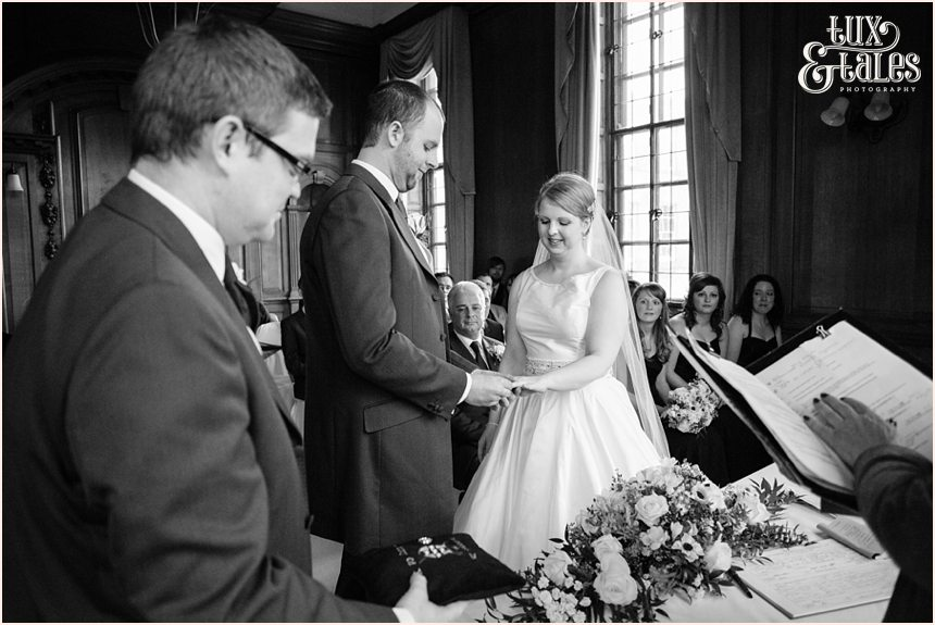 Bride and groom exchange rings at wedding at Credar Court Grand Hotel in York