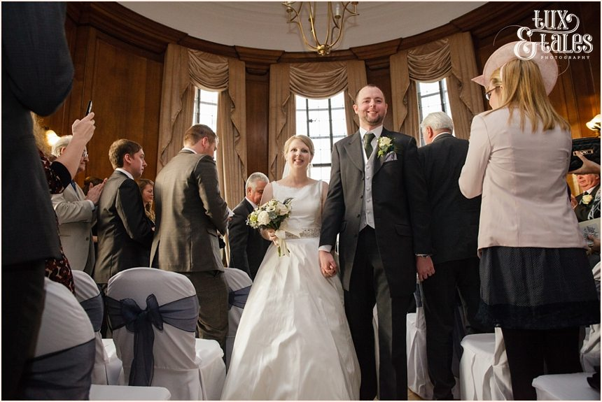Bride and groom walk back up aisle at Cedar Court Grand Hotel Wedding.
