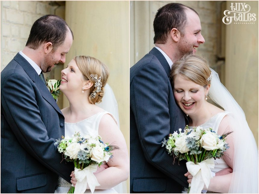 Bride and groom smile and hug at York winter wedding
