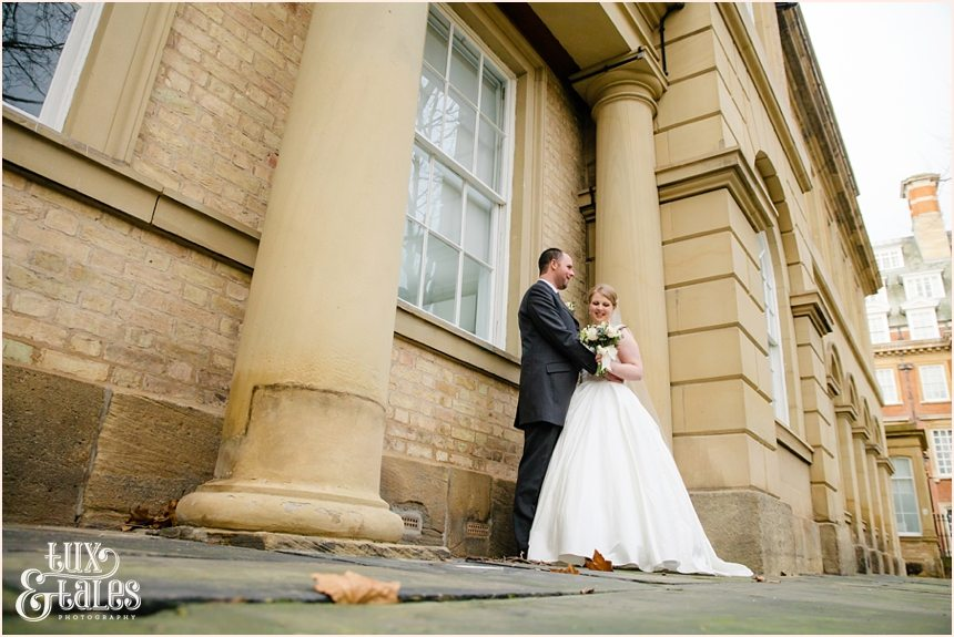 Bride and groom cuddle at York Wedding