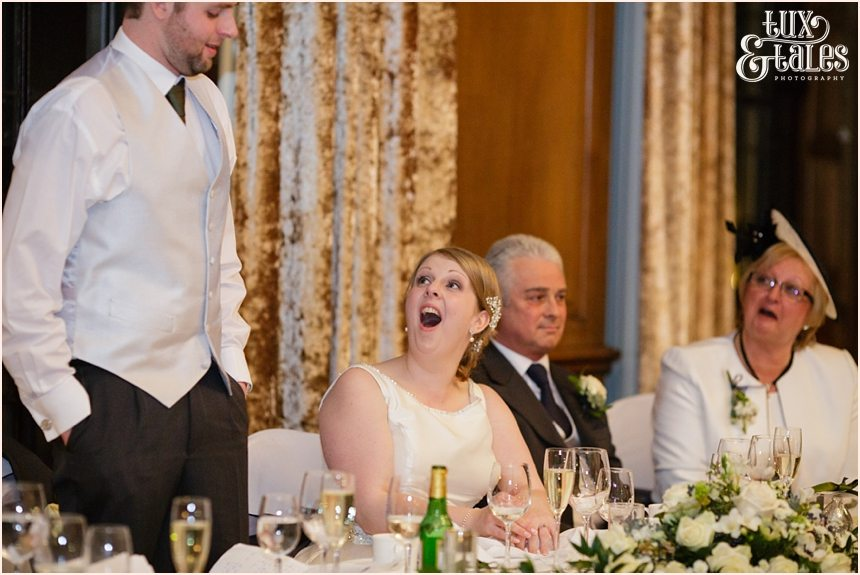 Speeches at York wedding and the bride is laughing and smiling