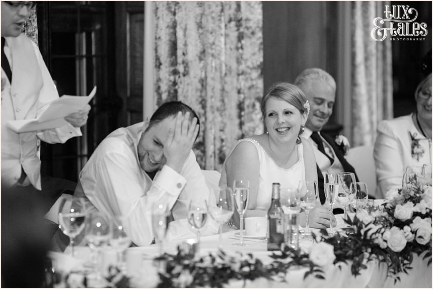 Groom hides his face during best man speech