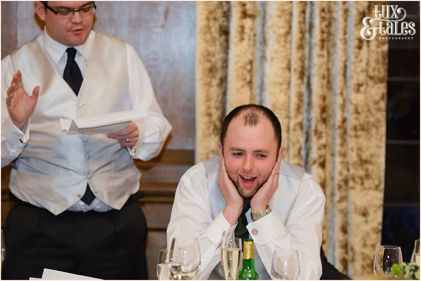 Groom covers his ears during best man speech at Cedar Court Grand Hotel Wedding