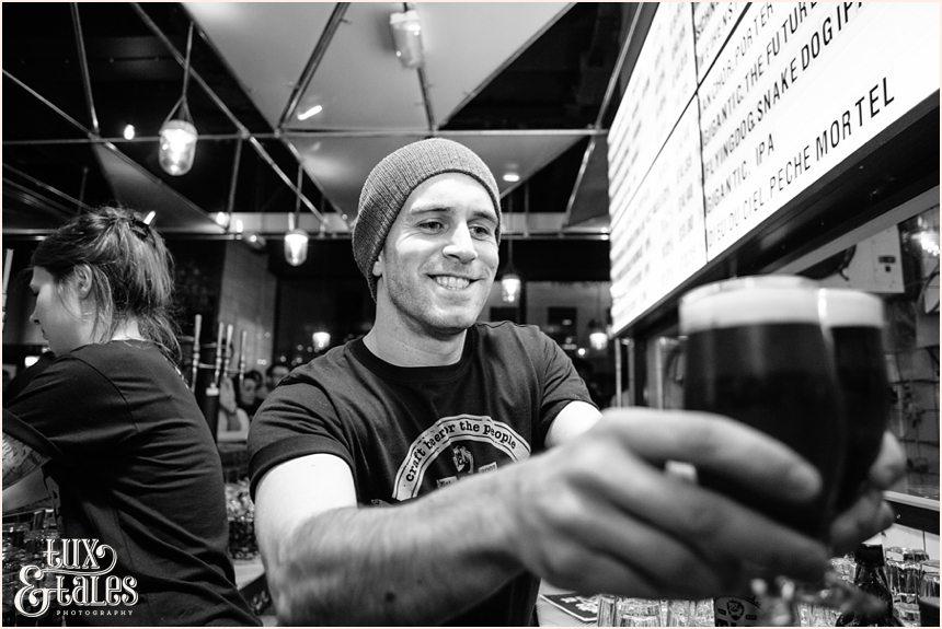 Bartender serves drink at Brew Dog Sheffiled