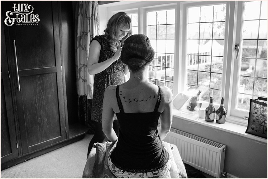 Winter wedding at the Hogarths Hotel bride getting makeup put on