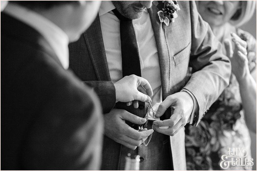 Heirloom watch being adjusted at hogarths hotel wedding