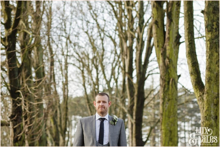 Groom photography in the trees at the Hogarths Hotel