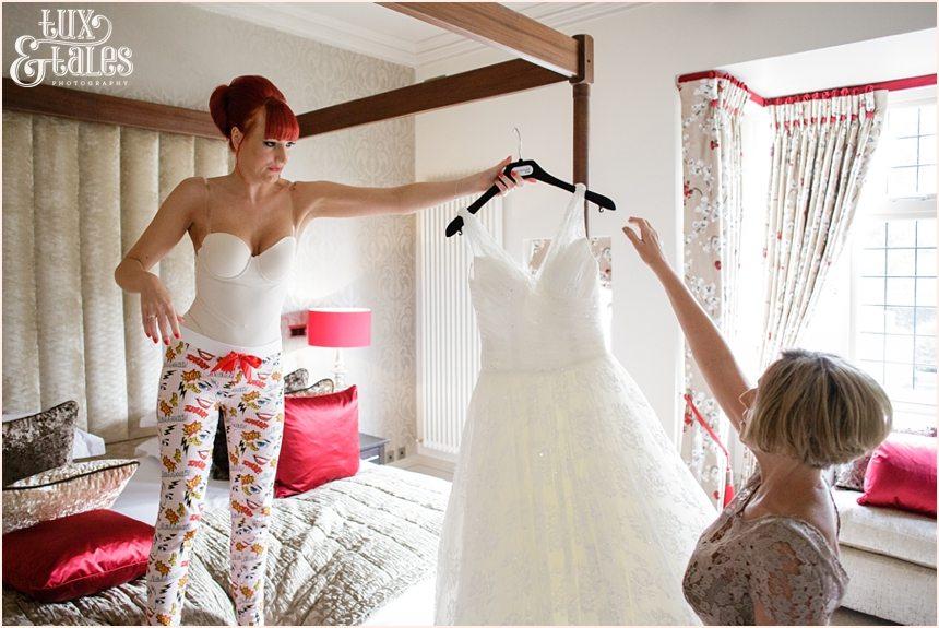readhead bride holding dress at hogarths hotel