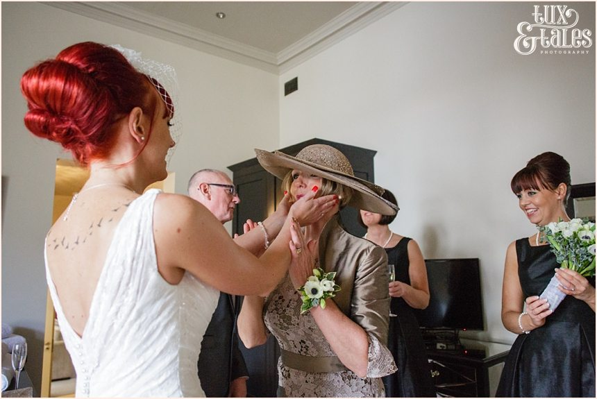 Bride holds mothers face in touching moment at hogarths hotel