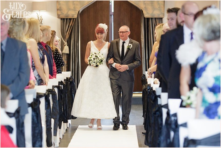 Bride walking up aisle at Hogarths Hotel Wedding