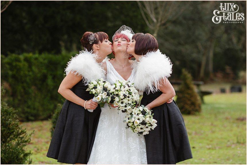 Bridesmaids kiss bride at hogarths hotel wedding