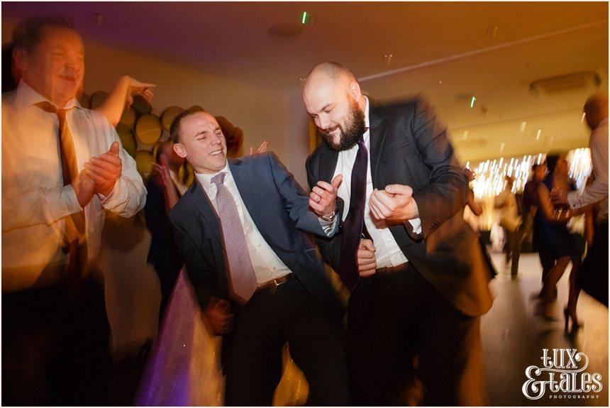 Guests doing air guitar at hogarths hotel wedding