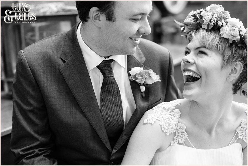 Happy bohemian bride laughs with new husband