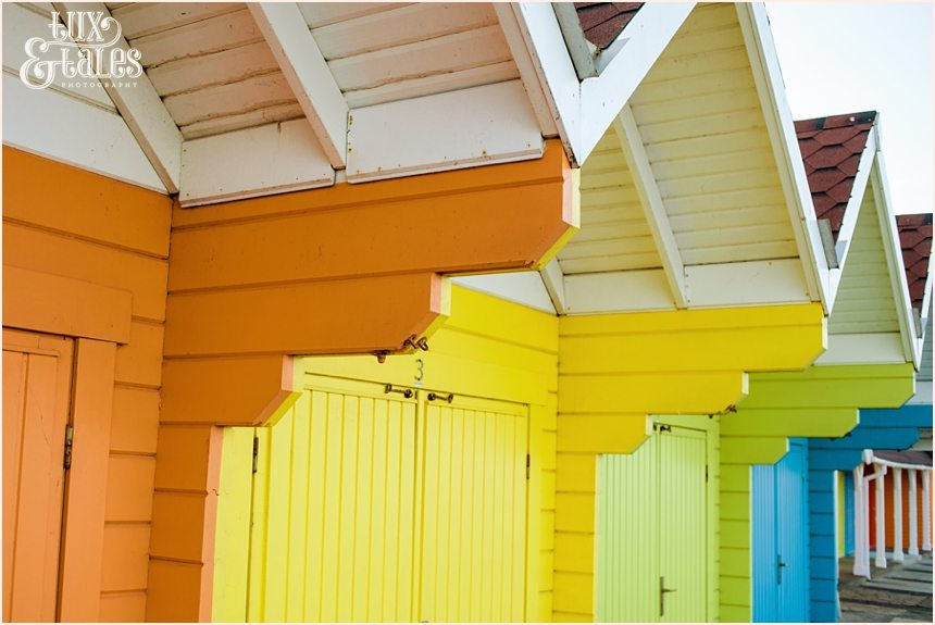 Rainbow coloured beach huts in North Beach Scarborough