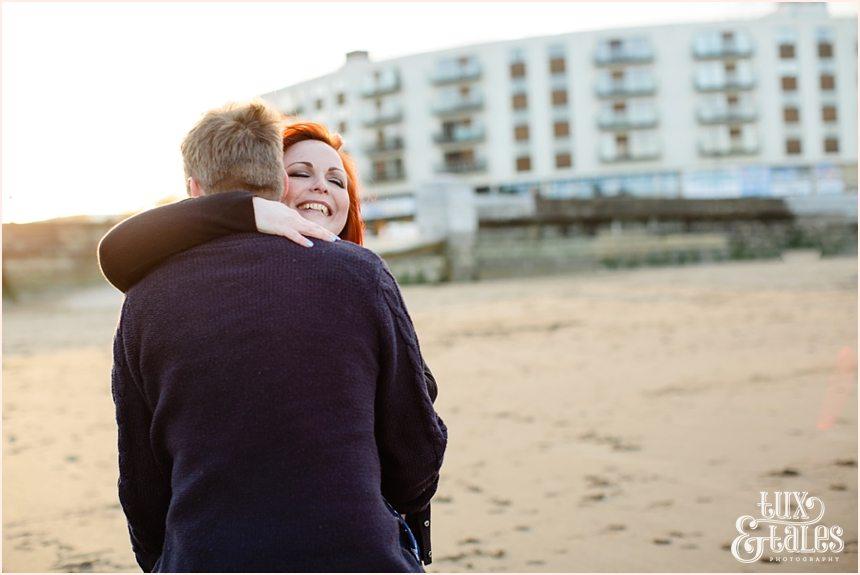 Gorgeous redhead hugs fiance