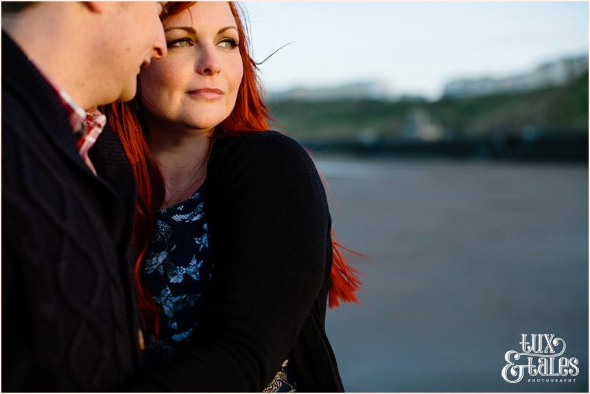 Couple snuggle in afternoon light in Scarborough engagement shoot