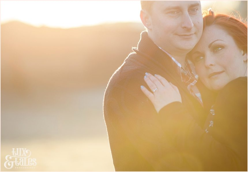 Gorgeous couple snuggle in the sunset at Scarborough north beach