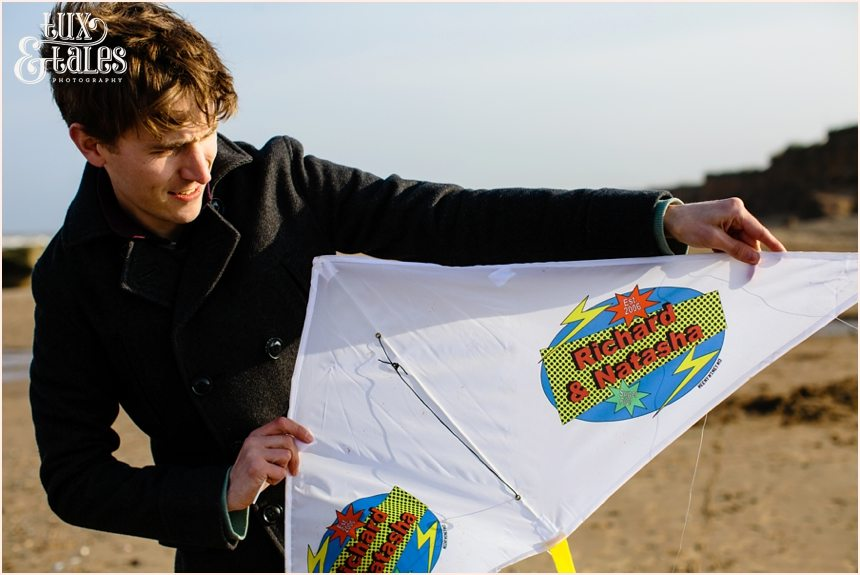 handmade kite at yorkshire beach engagement shoot