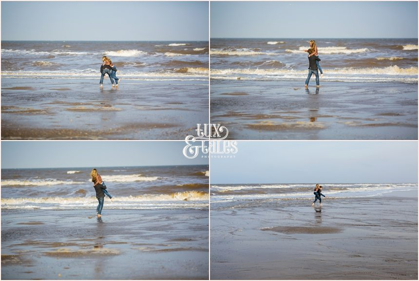 cute couple play in the water at Fristhorpe beach engagement shoot