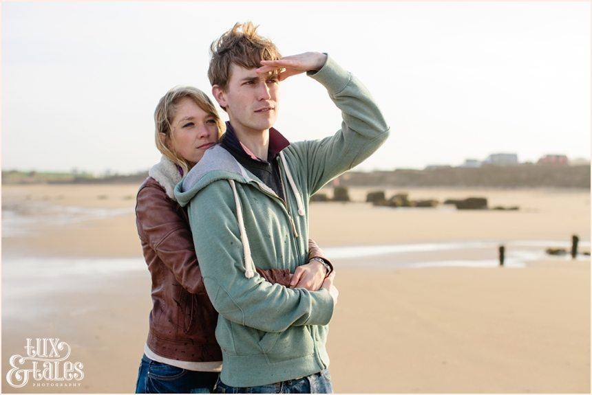 couple makes silly faces at Fraisthorpe beach engagement shoot