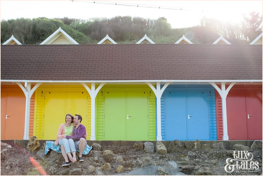 colourful couple have a fun engagement photography session at North Bay Beach in Scarborough